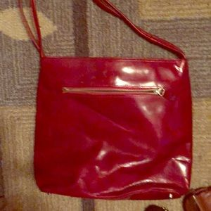 Monsac red shoulder bag. In good condition.